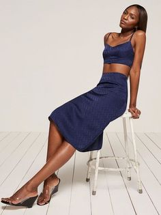 I'm not me without you. This is a tight fitting, two piece set with a cropped top and midi length skirt.