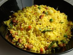 Vegetable Poha: 1 cup beaten rice flakes 1 onion small chopped 1/4 cup cauliflower cut into very small pieces 1 tbls chopped Carrot 1 tbls Green peas 1 smal potatol peeled and finely chopped 10 Curry leaves  1 tbls Oil  1 tsp Mustard seeds 1/2 tsp Cumin seeds Salt to taste