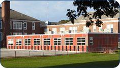 Exterior of Newton Oak Hill Middle School green modular classroom addition. Prefab classrooms, permanent modular construction #redefiningmodular