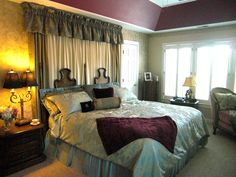 Drapes and sheers above the bed add height and elegance to the bedroom.  Photo credit Lady Glynstewart.