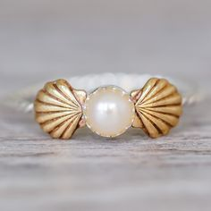 Mermaid Sea Shells and Pearl Ring ❤ liked on Polyvore featuring jewelry, rings, pearl jewelry, sea shell ring, seashell jewelry, white pearl ring and pearl ring