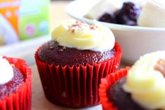 Red Velvet Cupcakes with Frosting and Flakes @juliescafebakery.com