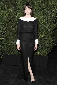 Felicity Jones wore a Chanel spring/summer 2013 floor-length dress with black and transparent heels also from the collection to the Chanel dinner.