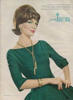 1961 - TRIFARI - ADS Continental... a shimmering fall of splendor in the Reaissance manner ... in golden-toned Trifanium. The adjustable twin-tasseled necklace, $15.00. Tasseled earrings, $10.00. Bracelet, $7.50. Prices plus tax. Jewelry by TRIFARI