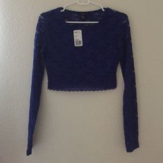 Blue lace long sleeve crop top Back and sleeves are see through, not the front. Fast Shipping No Trades, accept offers  bundle discounts with 2 items or more  Check out others items. Forever 21 Tops Crop Tops