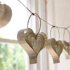 Hanging Hearts Cut strips of paper from books, hymns, or colored paper and staple at one end. Then flip the strips inside out and staple again. Now you have CUTE hearts to hang!