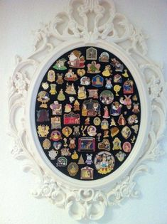 Upcycle a thrifted mirror or ornate frame as a display for trading pins! I think it would be cool to have a black one like this with haunted mansion wallpaper fabric in the background. Or use outdated lanyards as the background. There are soooo many possibilities :D by delia