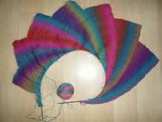this one is on the needles. i can almost understand the construction...      wheatiegirl's Wingspan    In Wisdon Yarns Poem Sock