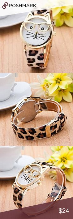 "Cat Face Watch with Leopard print Perrrfect time, every time!  The adorable white, numberless cat face, constructed of metal, is 30mm in diameter.  Ears peek out from the goldtone rim.  The leopard print watch band with gold accents completes the look.  Overall measurement is 9-1/4""L x 1-1/4""W.  6.5mm diameter SR626W button cell battery included. Happy Organics Boutique Accessories Watches"