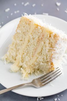 This Coconut Cake Recipe is made from scratch and full of bold coconut flavor and topped off with a coconut cream cheese frosting. This is the kind of cake that will wow everyone in the room!