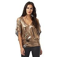 From our exclusive Star by Julien Macdonald collection, this top is ideal for adding a touch of retro-inspired glamour to an after-dark wardrobe. In an eye-catching gold textured finish, it features a stylish cold shoulder design with a deep V neck and a flattering bubble hemline. Team with slim trousers and a pair of high courts to complete a chic evening ensemble.