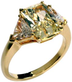 CARTIER Canary Diamond Ring | From a unique collection of vintage engagement rings at http://www.1stdibs.com/jewelry/rings/engagement-rings/