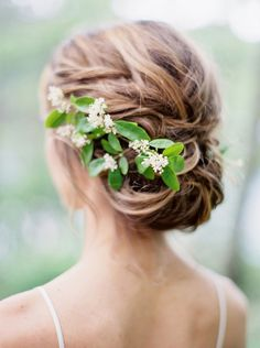 Love this updo with simple white flowers and greens ~ we ❤ this! moncheribridals.com