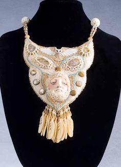 Minerva by Larkin Jean Van Horn - porcelain owl by Laura Mears, porcelain face by Diane Briegleb