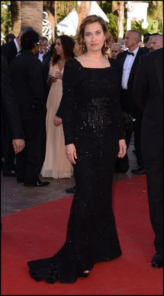 Emmanuelle Devos in a black ELIE SAAB Ready-to-Wear gown to the Cannes Film Festival Opening Ceremony.
