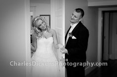 Cute photo of couple before the ceremony. They didn't want to see each other so they stood on either side of the door holding hands.