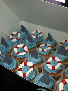 shark fins & life saver cupcakes - cute!                                                                                                                                                      More