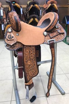 Jeff Smith C3-Barrel Saddle #4117 Seat: 14.5in | Swell Height: 9in | Swell Width: 13in | Cantle Height: 5in | Skirt Size: 23.5in | Finished, Hand dyed antique tooling. Black Gator Seat. Hand crafted conchos. Regular Fit. $3799.99