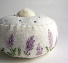 Just too sweet! Lavender flowers embroidered onto a handmade pincushion.