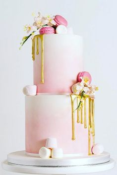 drip wedding cakes pink ombre is decorated with fresh flowers and macaroons cotswold cake kitchen