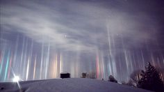 North Bay, Canada resident Timothy Joseph Elzinga recently sighted light pillars in the night sky after being awoken by his son in the middle of the night