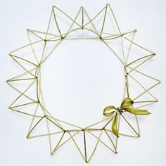 Make this geometric and modern wreath with coffee straws, wire, and gold spray paint.