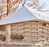 Japanese students at Waseda University have designed and built an innovative straw house that produces its own heat through agricultural fermentation.