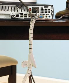 The Cable Tidy Cord Organizer is a flexible tube that hides all of those unsightly cables behind the TV or around the computer system. Organizing Wires, Cord Organization, Ltd Commodities, Cable Management, Tidy Up, Decoration, Simple Way, Playroom, Home Improvement