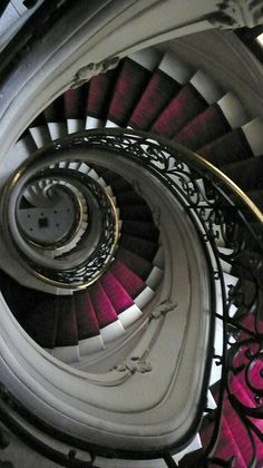 This staircase is an architectural feat and an amazing use of the spiral. The photographer's vantage point captures the never-ending feel of the spiral.