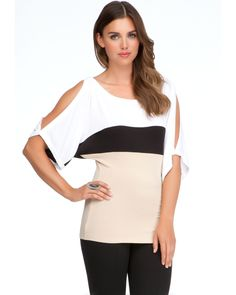With sexy cutouts at sleeves and high-impact colorblocking, this bebe top is sure to punch up your new-season wardrobe. Try it with a pair of skinny jeans and strappy sandals.