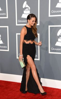 Chrissy Teigen Photos Photos - Model Chrissy Teigen arrives at the 55th Annual GRAMMY Awards at Staples Center on February 10, 2013 in Los Angeles, California. - The 55th Annual GRAMMY Awards - Arrivals