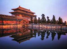 More at www.paulweeksphotos.com.  The sun was trying to peak through the haze on this early morning stroll around the Forbidden City in Beijing, China. For a brief moment it looked like the sun was even going to peak through, that's when I took this quick shot of the reflection near the main gate into the historic area. #china #world #travel #color #morning #forbiddencity #city #gate #wall #reflection #art #paulweeksphotos #architecture #beijing