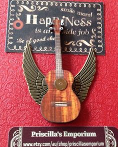 Items similar to Steampunk inspired 'Ukulele baby' with silver angel fairy wings, music on Etsy Cool Ukulele, Sculpture Art, Steampunk, My Etsy Shop, Inspired, Creative, Unique, Music, Handmade Gifts