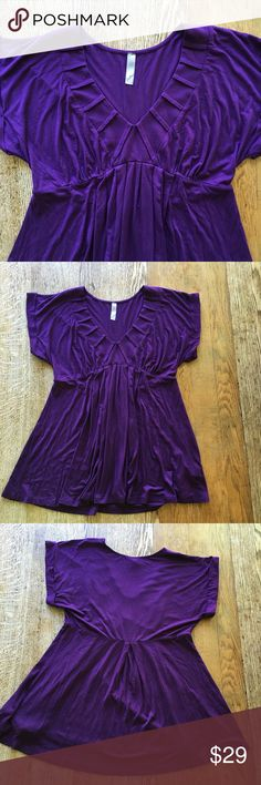Royal Purple Top Pre-loved in good condition! Royal purple top with stunning neckline and tailored waist. Size XL. Very elegant and super soft. 95% modal, 5% spandex Lush Tops