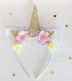 Your child will shimmer and shine in this sparkly gold unicorn party headband and will want to wear it everyday, it is so much fun! The ears are handmade from quality white acrylic and the horn is made from gold glitter fabric and has polyester stuffing so it will stand up straight. The