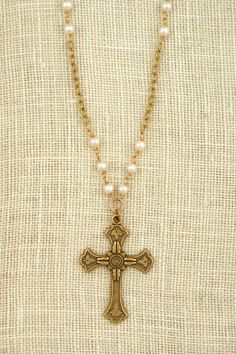 What's in your basket?   Freshwater pearl necklace with vintage cross pendant by Exvoto Vintage Jewelry.