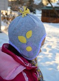LiEr from ikat bag recently showed how to make a fleece winter hat. She's back with another version, this one with ear flaps. You can keep it plain, or embellish it up with a pom pom at the…