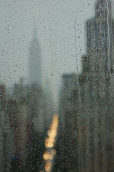 Reflections in the rain of the Empire State Building. New York City.