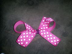 All pink with white polka dot bow