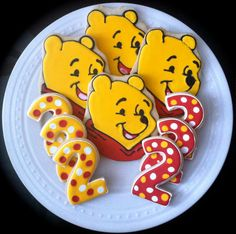 Winnie the Pooh decorated character and number by peapodscookies, $48.00
