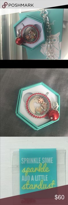 """Complete Origami Owl Christmas Locket! Beautiful Origami Owl Christmas locket! This complete set comes with a silver colored base, silver twist top with red Swarovski Crystals, red peal like dangle, 32"""" silver colored chain, al you need is love plate, and 4 charms (snow globe with reindeer in it, ginger bread house, stocking, rose gold colored snowflake). It also comes with red Swarovski stardust (ten small gems) if you want to add them in! Origami Owl Jewelry Necklaces"""