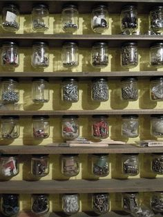 This is why Ive been hoarding all my used jam jars. Screw the lid to the underside of a shelf and hey presto! Classic viewable workshop storage!