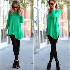 Kelley Green Asymmetrical Button Detail Tunic Top Tunic features button detail on side of tunic with an asymmetric hemline.  Material is 95% rayon and 5% spandex.  Lowest prices are listed upfront. Tops Tunics