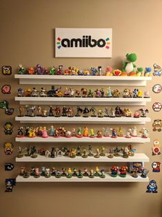 Perler Nintendo designs and custom made Perler amiibo logo sign. Amiibo Display, Funko Pop Display, Video Game Decor, Video Game Rooms, Nerd Room, Gamer Room, Nintendo Room, Picture Shelves, Otaku Room