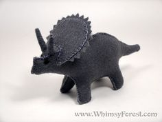This cute little toy dinosaur is named Talitha. It means the third spring. He is made of 100% wool felt. He is stuffed with wool and sewn with