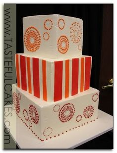 cake wedding three 3 tier offset square orange red fall summer colors dot circles fireworks 60's hippie stripes tall fun cute unique different awesome