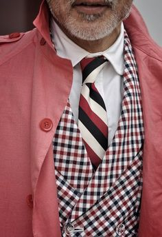 Patterns can be mixed as long as they are of different sizes. Notice the large stripes with the smaller checks. The tie picks up every color of the outfit beautifully.