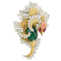 Two-Color Gold, Cabochon Emerald, Diamond, Coral and Ruby Sea Dragon Clip-Brooch  18 kt., the stylized sea dragon fashioned of concave gold scales, edged by white gold scales set with 132 round and 14 single-cut diamonds approximately 5.15 cts., centering one oval cabochon emerald approximately 23.00 cts., its head topped by one pear-shaped coral approximately 10.0 x 7.6 mm., accented by 2 marquise-shaped ruby eyes, approximately 23 dwts.