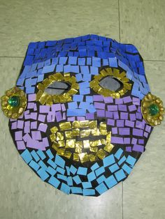 3rd grade Ancient Mayan style paper mache mosaic mask (mosaics made of painted card stock) lesson designed by art teacher: Susan Joe