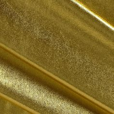 Polyester Spandex Lame Knit Gold from @fabricdotcom  This lame knit fabric features a metallic gold foil finish and four way stretch. With 50% four way stretch, this lightweight knit is perfect for leotards, costumes, leggings, dancewear, and form fitting apparel.